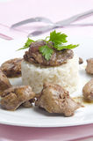 Chicken liver on rice with parsley Stock Images