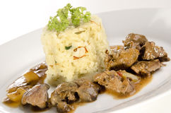 Chicken liver and rice with saffron Stock Photography