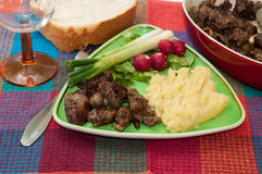 Chicken liver served with mashed potatoes, onions and radishes.  Stock Image