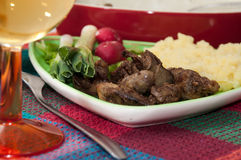 Chicken liver served with mashed potatoes, onions and radishes.  Royalty Free Stock Photos
