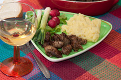 Chicken liver served with mashed potatoes, onions and radishes.  Royalty Free Stock Image