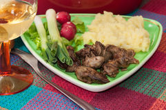 Chicken liver served with mashed potatoes, onions and radishes.  Stock Photos