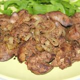 Chicken liver. Some fresh chicken liver with salad stock photo