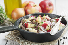 Chicken liver stewed with apples and onion Stock Image