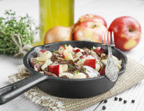 Chicken liver stewed with apples and onion Stock Images