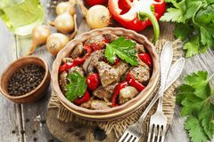 Chicken liver with sweet pepper and tomatoes. On the table stock image