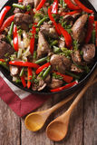 Chicken liver with vegetables close-up on a dish. vertical top v Royalty Free Stock Photo