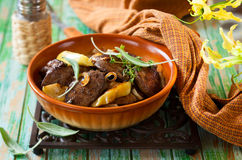 Chicken livers with apple. Pan-Fried Chicken Livers With Apple, Onion and Sage Royalty Free Stock Photography