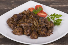 Chicken livers in a creamy sauce with onion Royalty Free Stock Photo