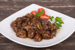 Chicken livers in a creamy sauce with onion Royalty Free Stock Images