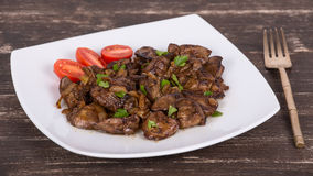 Chicken livers in a creamy sauce with onion Stock Images