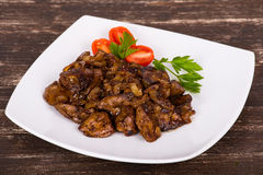 Chicken livers in a creamy sauce with onion Royalty Free Stock Photos
