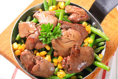 Chicken livers with green beans and corn Royalty Free Stock Images