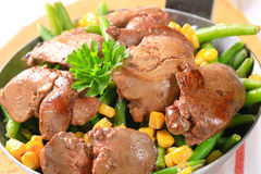 Chicken livers with green beans and corn Stock Image