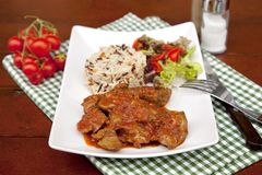 Chicken livers in a tomato sauce. With rice Stock Images