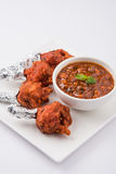 Chicken lollipop or chicken winglet. Served with tomato chutney, a chinese preparation Royalty Free Stock Photography