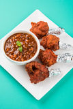 Chicken lollipop or chicken winglet. Served with tomato chutney, a chinese preparation Royalty Free Stock Images