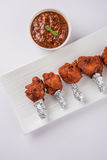 Chicken lollipop or chicken winglet. Served with tomato chutney, a chinese preparation Stock Photography