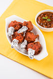 Chicken lollipop or chicken winglet. Served with tomato chutney, a chinese preparation Stock Images