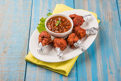 Chicken lollipop or chicken winglet. Served with tomato chutney, a chinese preparation Royalty Free Stock Photos