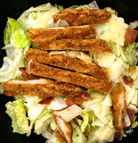 Chicken lunch. Light lunch of caesar salad chicken meat bacon  cheese  lettuce closeup Stock Image