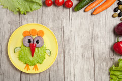 Chicken made of vegetables on table with ingredients royalty free stock photo