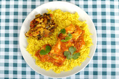 Chicken Madras Curry with Rice on a Plate Royalty Free Stock Photography