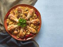 Homemade chicken Biryani on a blue background. Top view stock photo