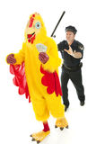 Chicken Man on the Lam. Chicken man holding stolen cash and running from a police officer.  Isolated on white Stock Image