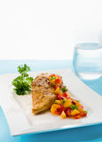 Chicken with mango salsa stock image