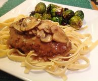 Chicken Marsala with Brussels Sprouts Stock Photos
