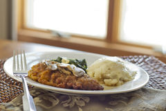 Chicken Marsala. Crispy breaded chicken marsala with mashed potatoes and broccoli rabe with garlic royalty free stock photos