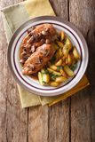 Chicken in Marsala sauce with mushrooms and fried potatoes close Stock Image
