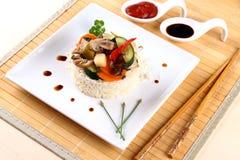 Chicken meat, asian rice, zucchini, carrots, mushroom Stock Image