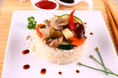 Chicken meat, asian rice, zucchini, carrots, sauces Royalty Free Stock Images
