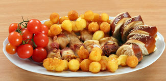 Chicken meat with bacon potatoes and tomato Stock Photo