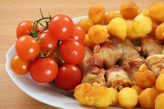 Chicken meat bacon tomato and potatoes Royalty Free Stock Photo