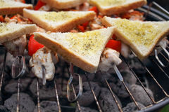 Chicken meat, BBQ. Summer barbecue, chicken meat, BBQ with vegetables and brad Royalty Free Stock Photography
