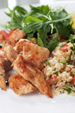 Chicken meat with bulgur and rocket salad Stock Photo