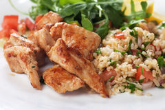 Chicken meat with bulgur and rocket salad Stock Photography