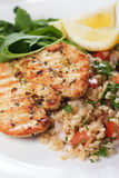Chicken meat with bulgur and rocket salad Stock Image