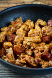 Chicken meat and chorizo cooking in the frying pan Royalty Free Stock Photography