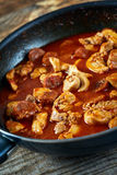Chicken meat and chorizo cooking in the frying pan Stock Image
