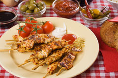 Chicken meat on ckewer. Barbecued chicken meat on skewer served as party food Royalty Free Stock Image