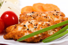 Chicken meat cutlet with vegetables. Chicken chopped meat cutlet with vegetables and greens Stock Images