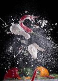 Chicken meat with flour in freeze motion Stock Photos