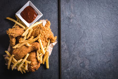 Chicken meat and french fries Royalty Free Stock Image