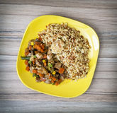 Chicken meat with fried rice and steamed vegetables, serving foo Royalty Free Stock Photo