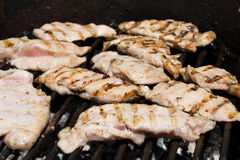 Chicken meat on the grill stock images