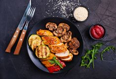 Chicken meat with grilled vegetables stock photos